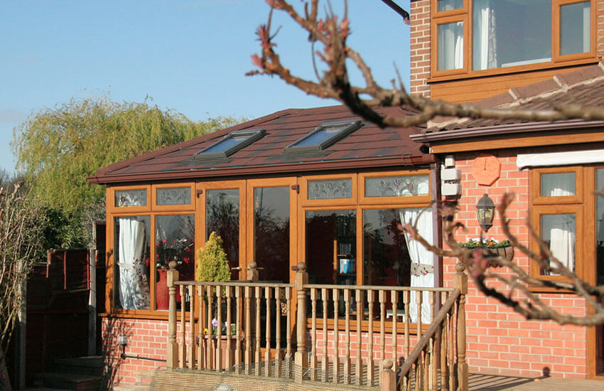 Golden oak conservatory with tiled roof