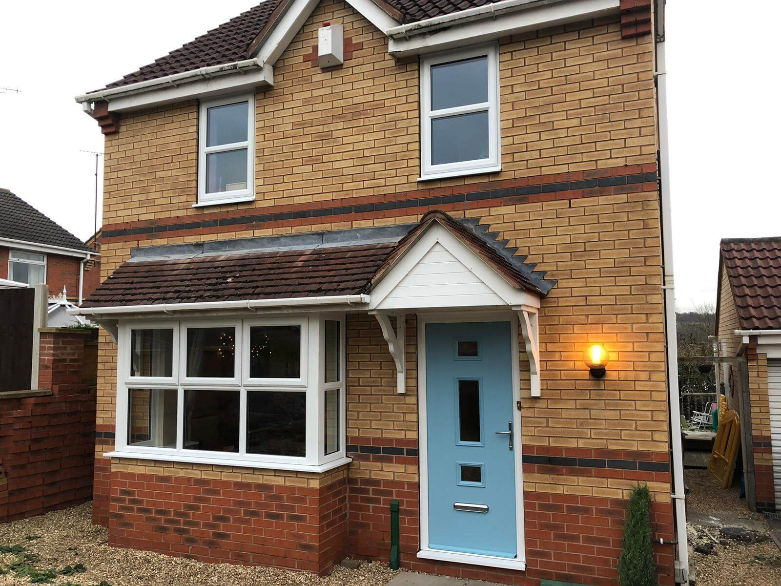 Duck egg blue composite door and white uPVC windows sheffield home