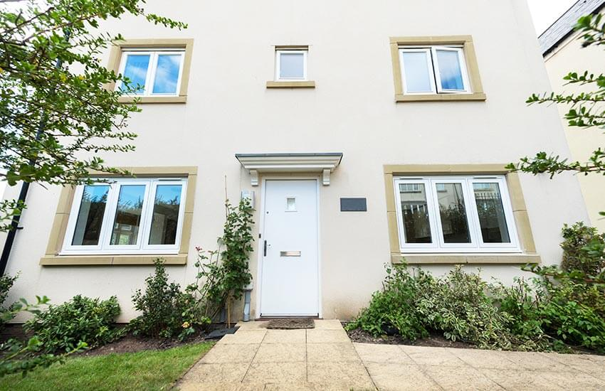 House front with white flush sash windows
