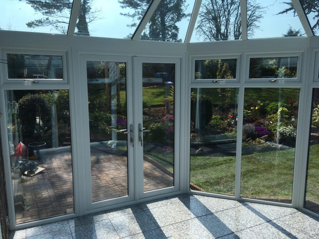 French doors in uPVC conservatory