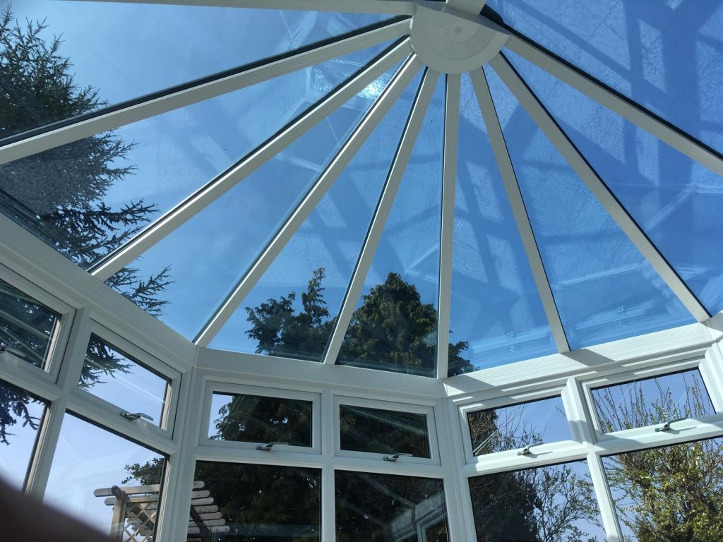 Grey on white glass conservatory roof interior