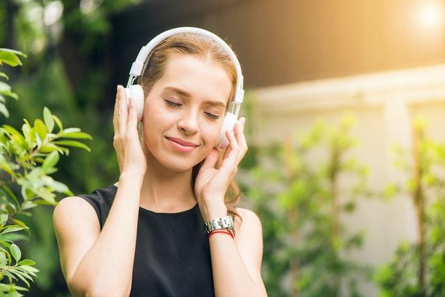 woman wearing headphones in garden